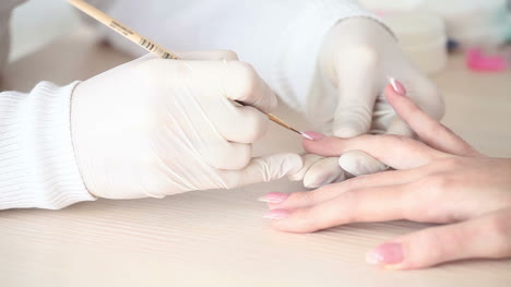 Manicurist-Draws-On-Nails-Closeup