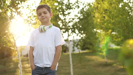 Portrait-Of-A-Boy-Outdoors-Against-Sunlight