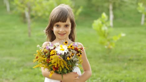 Portrait-Of-A-Girl-With-A-Bouquet-Of-Flowers-The-Child-Goes-Out-Of-Frame