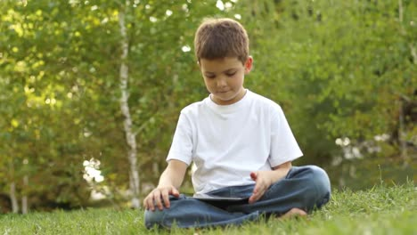 Schoolboy-With-A-Tablet-PC-Thumbs-Up-Ok