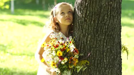 Smiling-Girl-With-Bouquet-Of-Flowers-Near-The-Tree-01