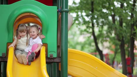 Two-Happy-Girls-On-The-Playground