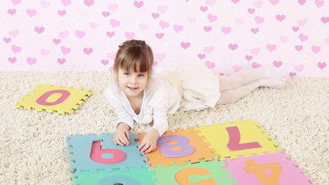 Young-Girl-Playing-On-The-Floor
