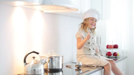 Girl-Chef-With-A-Ladle-Shows-Okay