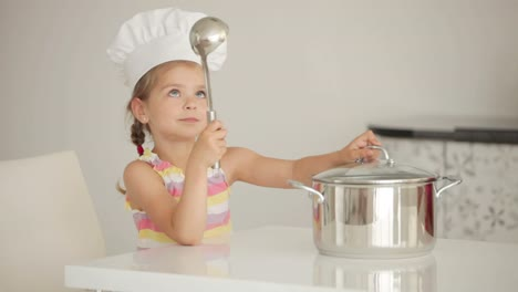 Girl-Cook-With-A-Saucepan-And-Ladle