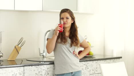 Girl-Drinking-Juice-And-Smiling