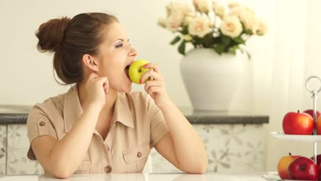 Girl-Eating-An-Apple-And-Looking-Out-The-Window