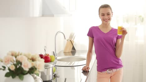 Girl-Is-Standing-In-The-Kitchen-And-Drinking-Juice