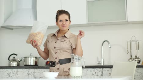 Girl-Is-Standing-In-The-Kitchen-And-Eating-Cereal