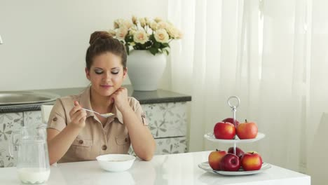 Girl-Sitting-At-Table-And-Eat-Breakfast