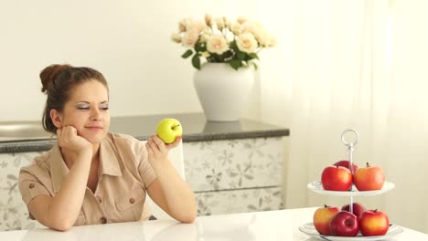Girl-Sitting-At-Table-And-Eating-An-Apple