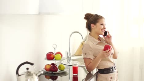 Girl-Standing-In-Kitchen-And-Talking-On-The-Phone
