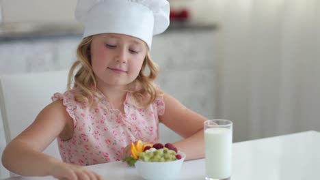 Girl-With-Fruit-Yogurt-And-A-Glass-Of-Milk