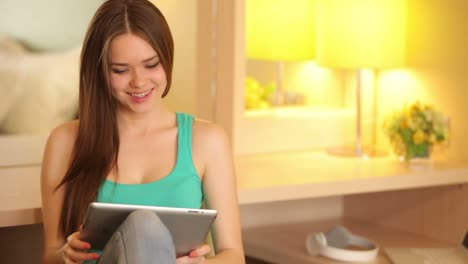 Girl-With-The-Tablet-Chatting-Online