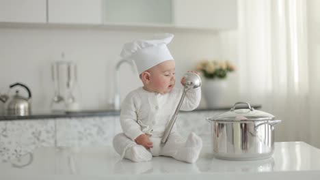 Little-Chef-With-A-Ladle-Knocking-Over-A-Pan-And-Laughs