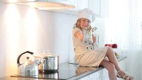 Little-Girl-Chef-With-A-Ladle-Showing-Thumbs-Up