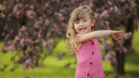 Little-Girl-Spinning-In-The-Garden-And-Laughing