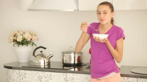 Lovely-Girl-Standing-In-Kitchen-And-Has-Breakfast