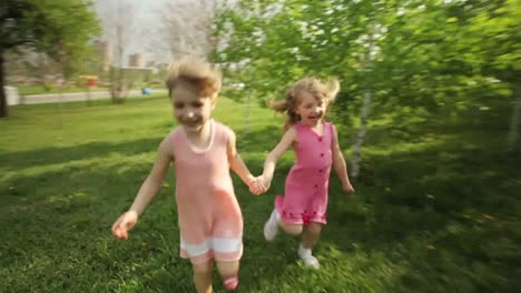 Sisters-Running-Around-In-Garden-And-Laughing