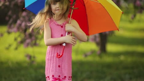 Sweet-Girl-Jumping-With-Umbrella