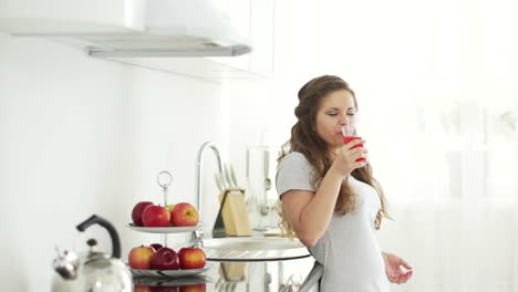 Teenager-Drinking-Delicious-Juice-And-Smiling