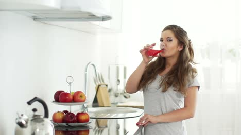 Young-Woman-Goes-To-Table-And-Drinking-Delicious-Juice