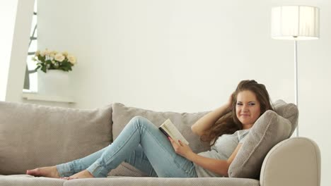 Young-Woman-Reading-Book-And-Smiling-01