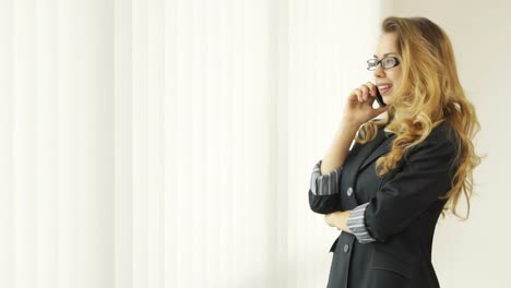 Attractive-Young-Woman-Wearing-Glasses-Dressed-In-Suit-Standing