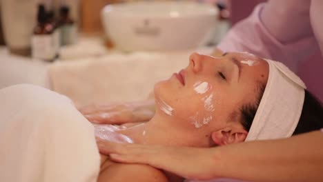 Beautician-Doing-Professional-Massage-Of-Female-Face-And-Body-At-Beauty-Salon