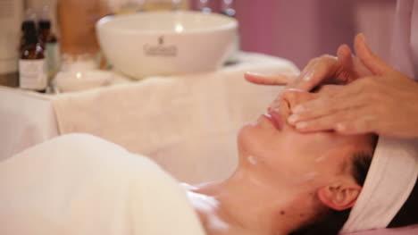 Beautician-Doing-Professional-Massage-Of-Female-Face-At-Beauty-Salon