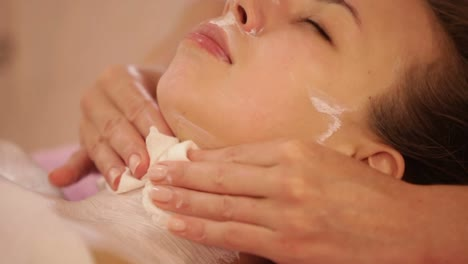 Beauty-Specialist-Cleaning-Female-Face-From-Moisturiser-At-Beauty-Salon-Panning