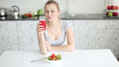 Pretty-Young-Woman-Sitting-At-Table-With-Bowl-Of-Salad-In-Front-Of-Her