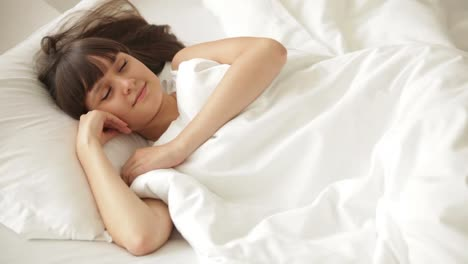 Cute-Girl-Sleeping-In-Bed-Moving-And-Smiling-In-Her-Sleep