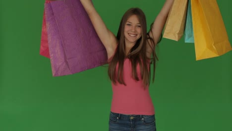 Cute-Girl-Standing-With-Shopping-Bags-And-Smiling-on-greenscreen