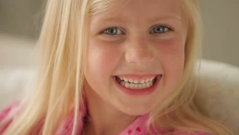 Funny-Little-Girl-Looking-At-Camera-And-Smiling