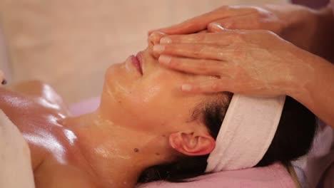 Massage-Therapist-Massaging-Woman-s-Face-And-Body-At-Beauty-Spa-Panning-Camera