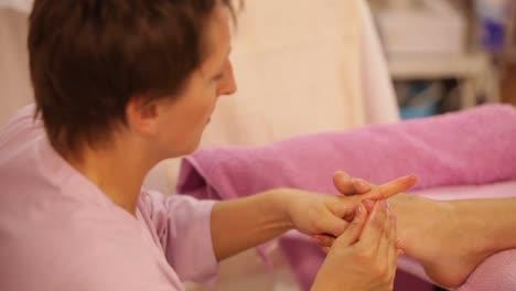 Professional-Massage-Therapist-Doing-Massage-Of-Female-Feet-At-Beauty-Salon