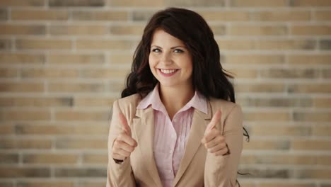 Cheerful-Young-Woman-Showing-Thumb-Up-And-Smiling-At-Camera