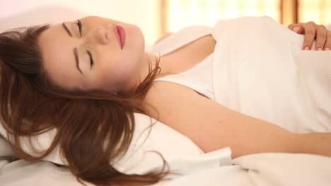 Cute-Girl-Sleeping-In-Bed-Moving-And-Smiling-In-Her-Sleep-Panning-Camera
