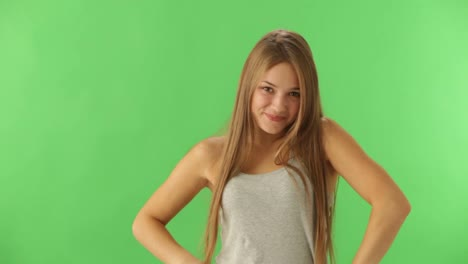 Cute-Young-Woman-Standing-On-Green-Background-Expressing-Astonishment-Looking