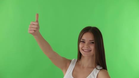 Happy-Girl-On-Greenscreen-Background-Smiling-And-Showing-Thumb-Up-At-Camera