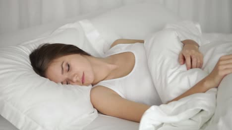 Young-Woman-Sleeping-In-Bed-And-Moving-While-Sleeping-Panning-Camera