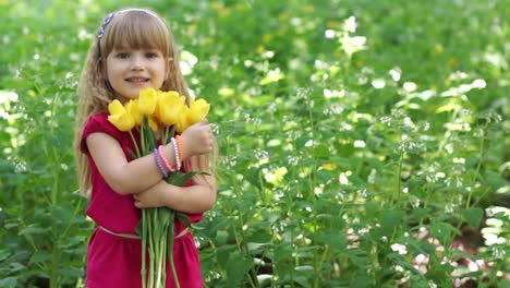 3s-Girl-Hugging-A-Bouquet-Of-Yellow-Tulips