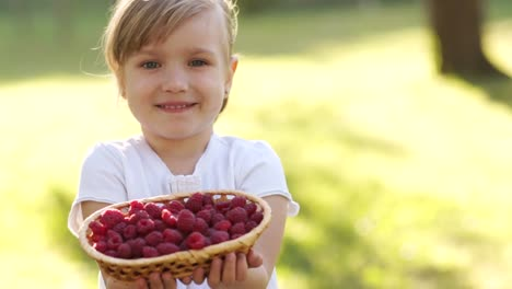Beautiful-Girl-With-A-Basket-Of-Raspberries