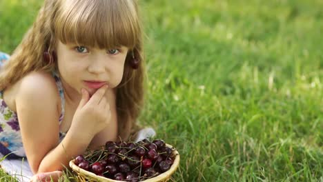 Child-Eating-Cherries-Lying-On-The-Grass