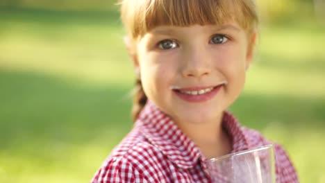 Closeup-Portrait-Of-Smiling-Girl-Drinking-Milk-Outdoors-Milk-Mustache