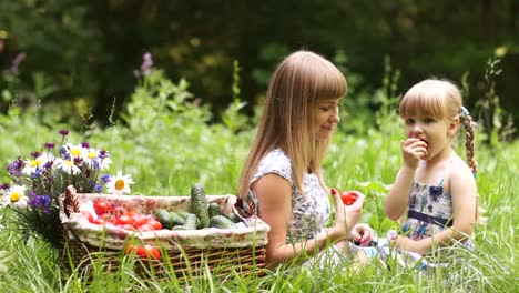 Family-With-Vegetables-In-Nature-They-Eat-Tomatoes