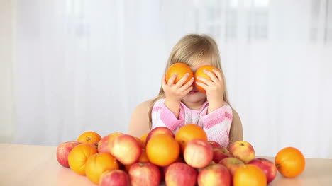 Girl-Dabbles-With-Oranges