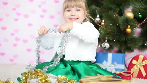 Girl-Decorates-The-Christmas-Tree