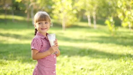 Girl-Drinking-Milk-Outdoors-Thumbs-Up-Ok